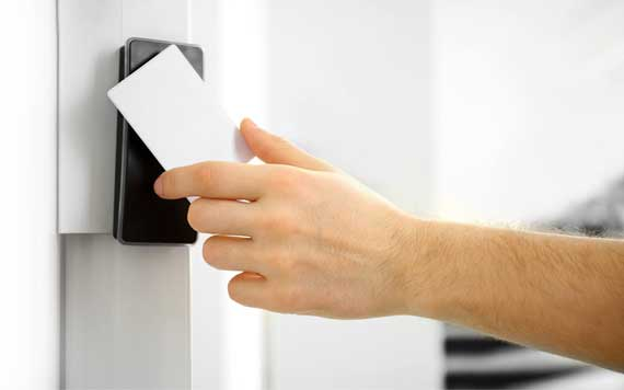 person using card key to unlock security device through tap