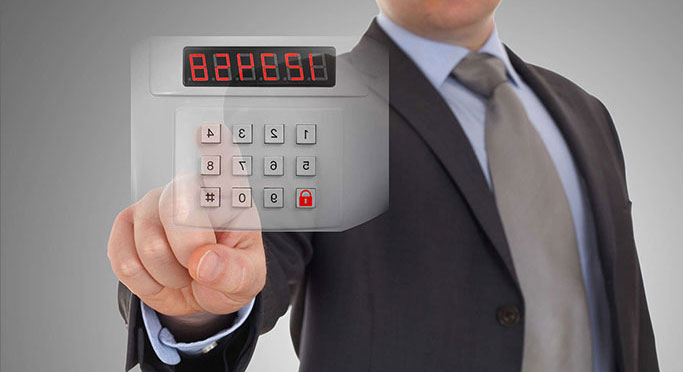 man inputting code to security device